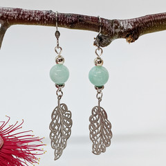 Turquoise jade dangle earrings with silver leaf charm