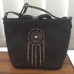 Vinyl handbag with chainmaille embellishment.