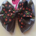 Large double layer grey and cherry pinwheel bow.