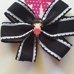 Black and pinwheel bow with embellishment.