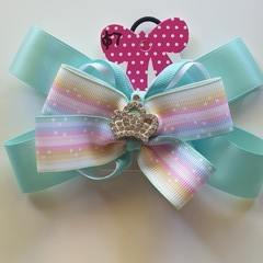 Triple layer fancy bow with embellishment.