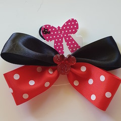 Red and Black bow with embellishment.