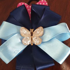 Navy and light blue pinwheel bow with embellishment