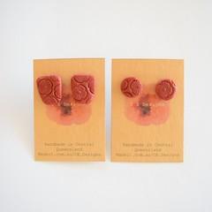 Burgundy embossed polymer clay stud earrings