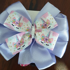 Purple and unicorn pinwheel bow.