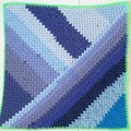 Baby blanket a patch of bluei in granny stripes with bright green border