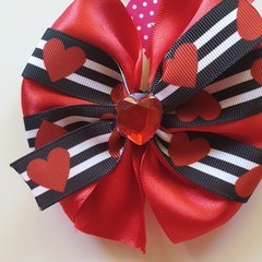 Red and Black medium pinwheel bow with embellishment.