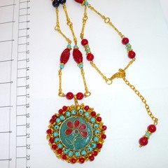 Tibet. style pendant in red, blue, turquoise and gold.
