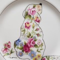 Hand painted Waterford plate featuring a floral dog