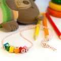 Children's necklace made form coloured pencils, bright and playful