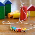 Children's necklace made form coloured pencils with yellow string ans smiley :)