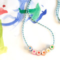 Children's necklace made form coloured pencils, rainbow colors