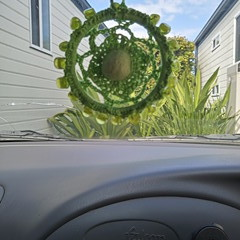 Hand crocheted car air freshener embellished with glass faceted beads.  Crochete