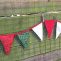 Christmas Bunting - red, white and green flags with a central red flag
