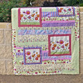 Cot quilt, floor rug, baby blanket, play rug. Pink, purple & green