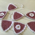 Pink and white crocheted bunting