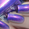 "Nail polish - ""Here We Go Again"" A bright blue with copper shimmer and holo"