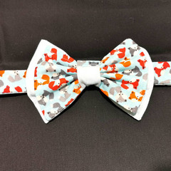 Fox bow tie. Teen/adult size. Velcro closure. Blue cotton with multicoloured fox