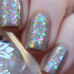 "Nail polish - ""Cohesion"" A clear based topper filled with iridescent flakes"