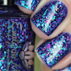"Nail polish - ""Card Trick"" A dark blurple base filled with flakes"
