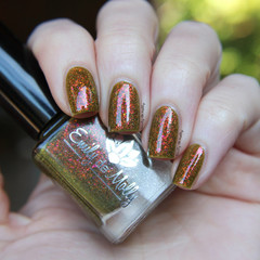 "Nail polish - ""Enjoy The Fall""  A khaki green base with iridescent flakes"