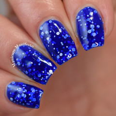"""Nail polish - """"Intensity"""" A bright blue with white glitters"""
