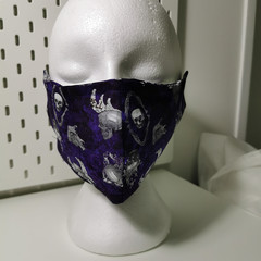 Washable facemask, skulls pattern. Halloween. Purple.