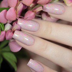 "Nail polish - ""Waiting To Happen"" A light dusty pink with glitters"