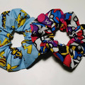 Pack of 2 Pokemon scrunchies. Pokeballs and Pikachu patterns.