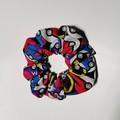 Pack of 2 Pokemon scrunchies. Pokeballs and Pikachu patterns.