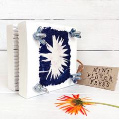 Mini Flower Press, decorated with original calendula flower cyanotype art