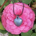 Solid concrete heart necklace.