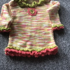 Little girls multicoloured jumper and matching hat.