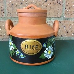 Pottery type terracotta Rice container.