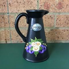 Terracotta decorative jug.