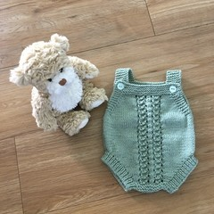 Hand knitted romper suit ideal for newborn.