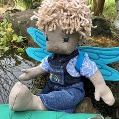 Boy doll with wings made from recycled materials