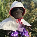 Doll with animal cape & clothes.  Recycled materials