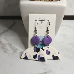 Purple cow patterned arch earrings