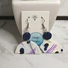 Blue patterned arch earrings (black stripe)