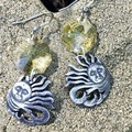 Pewter sun motif earrings  with yellow facetted sun catcher octagon beads.