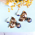 Matte Dark Blue Floral Bead with Gold Half Twist Round Earrings.