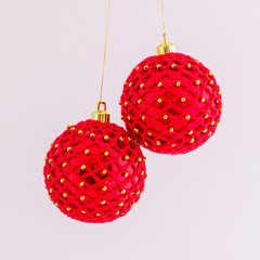 Pair of red crocheted Christmas baubles with gold beads
