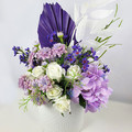 Purple & White Artificial Flower Arrangement with Purple Palm Leaf in White Vase