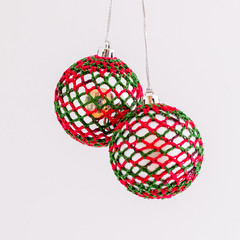 Pair of red and green crocheted Christmas baubles