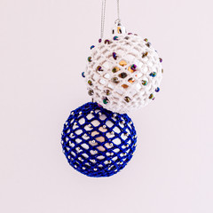 Pair of white and blue crocheted Christmas baubles
