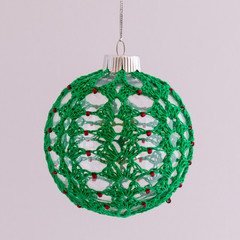 Green lace with red beads crocheted Christmas bauble
