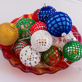 White lace crocheted Christmas bauble with red and green beads