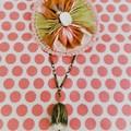 Pink and tan vintage barkcloth Suffolk puff brooch