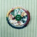 Brooch made from vintage barkcloth yo yos